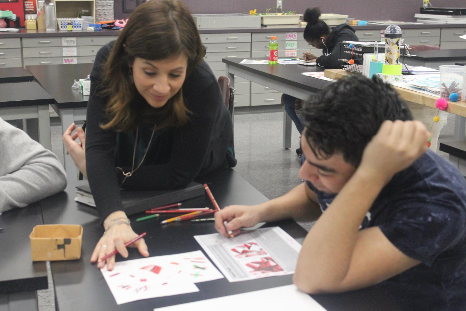 Allison Kegley helps a student during art class. Kegley was recently named the Ben Davis Teacher of the Year.