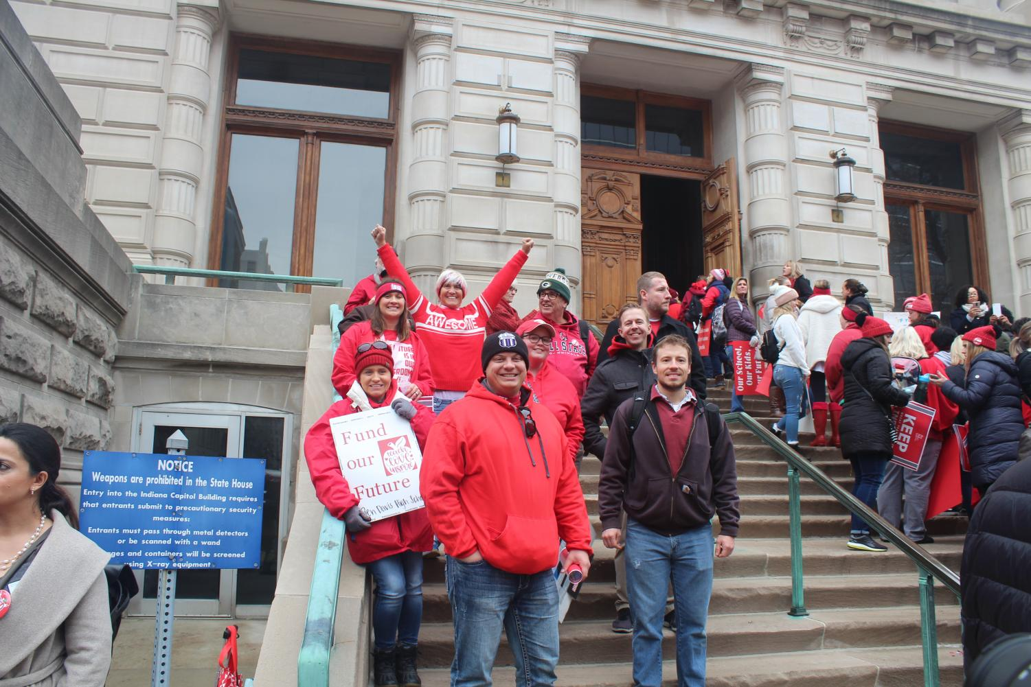 A group of Ben Davis teachers gather on the steps of the Indiana Statehouse at Tuesday's RedforEd rally.