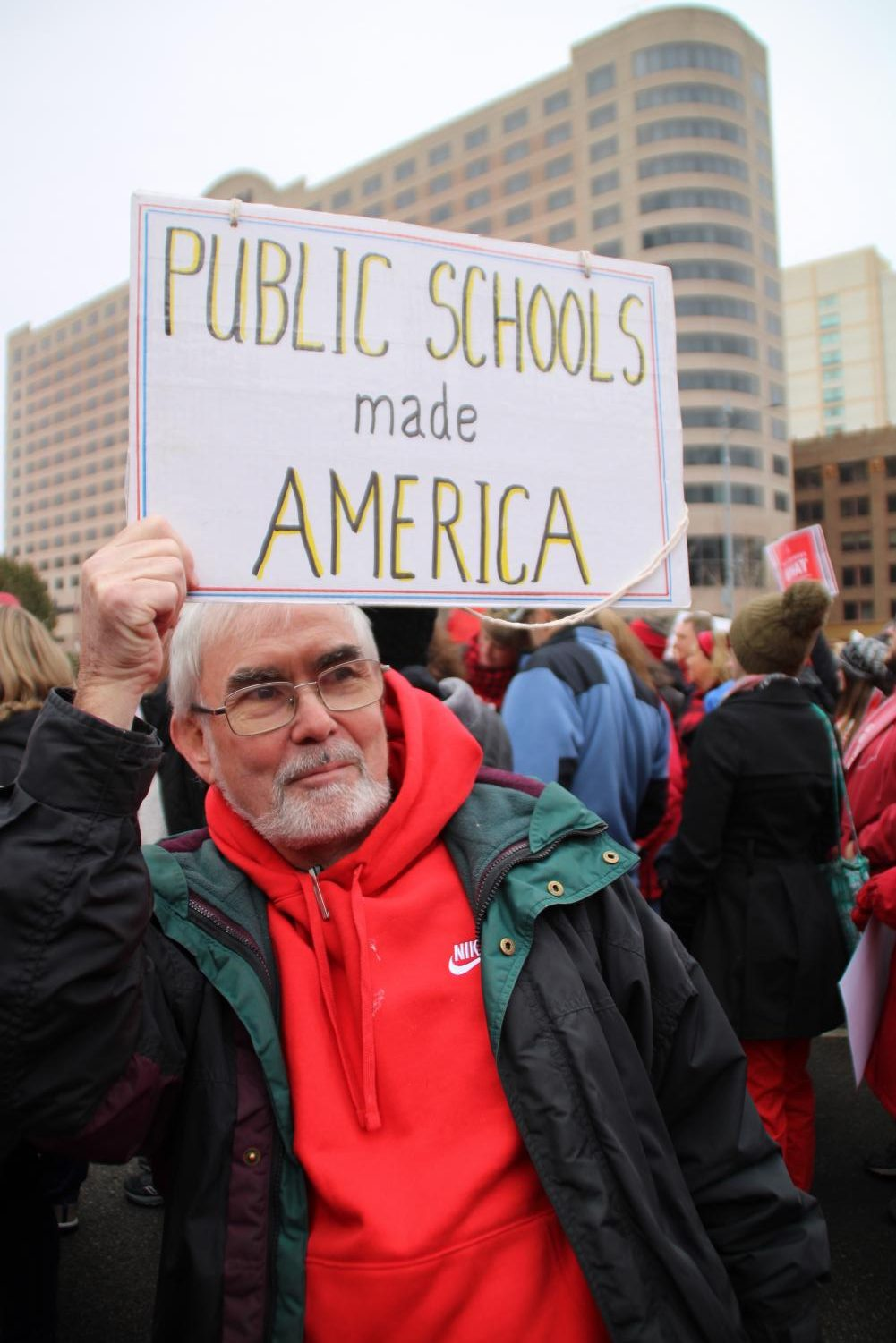 Latin teacher Bill Gilmartim holds up a sign during last weeks RedforEd rally downtown.
