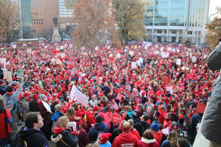 A+crowd+estimated+at+15%2C000+gathers+outside+the+Statehouse+Tuesday+morning+at+the+RedforEd+rally.