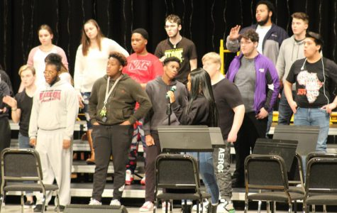 The choir practices in the auditorium Wednesday in preparation for Friday's Cabaret.
