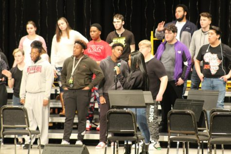The choir practices in the auditorium Wednesday in preparation for Friday