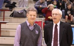Joe Lentz (left) and Stan Benge (right) have a discussion at a game