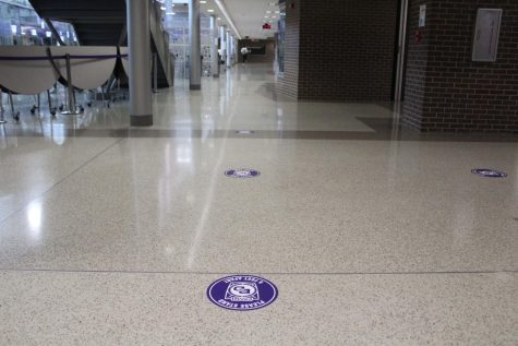 "The new ""norm"" includes floor signs indicating where people should stand."