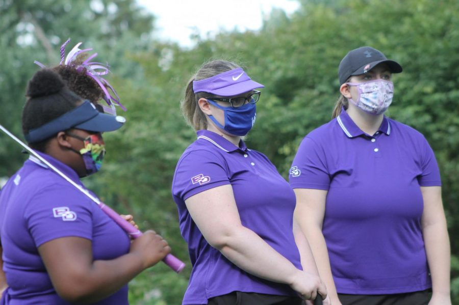 Members+of+the+girls+golf+team+protect+themselves+with+clothe+masks+before+the+first+meet+of+the+season.+
