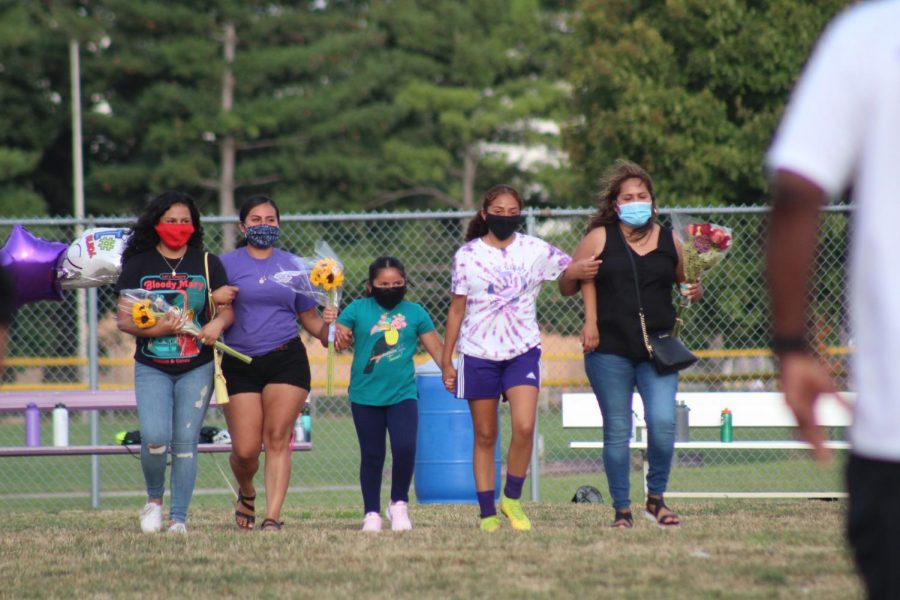 Masks+are+worn+by+players+and+fans+during+girls+soccer+Senior+Night.