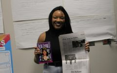Leah Johnson poses with her first book You Should Me in a Crown and her first article in the Spotlight during a visit to Ben Davis last year.