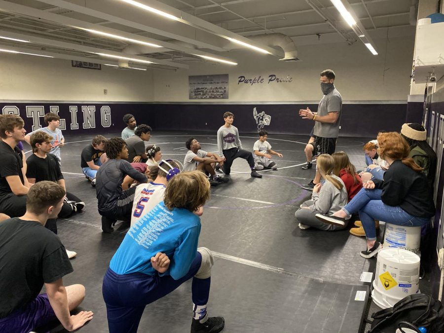 Wrestling coach Jordan Knudsen addresses his team prior to a recent practice. The team starts the season Nov. 25 at the Edgewood Invitational.