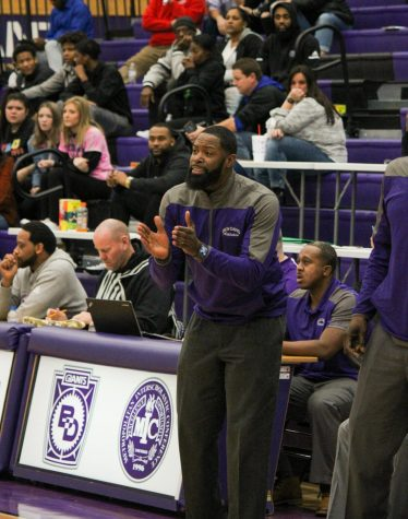 Coach Don Carlisle encourages his team during a Marion County tourney game last season. This is Carlisle