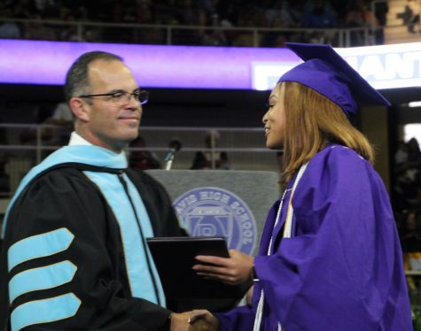 Wayne Township Superintendent Dr. Jeff Butts greets a graduate during the 2019 graduation. Plans this year are to have two seperate graduation ceremonies on June 7 at Indiana Farmers Coliseum.