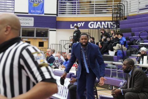 Boys basketball coach Don Carlisle shows his intensity during a recent game against Cathedral. The Giants will play Friday at 6 p.m. in the Decatur Central sectional.