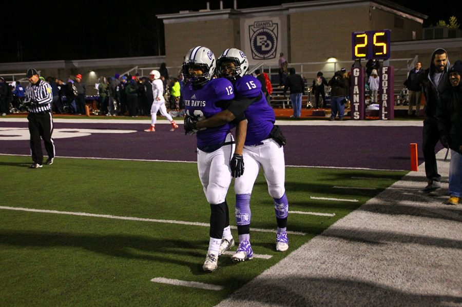 Chris Evans (No. 12) gets congratulated after scoring the winning touchdown in a 2014 semistate game against Center Grove. Evans was drafted in this years NFL draft.