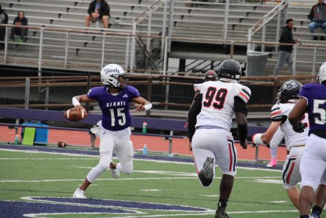 Senior quarterback JUan Swanson looks for an open receiver.